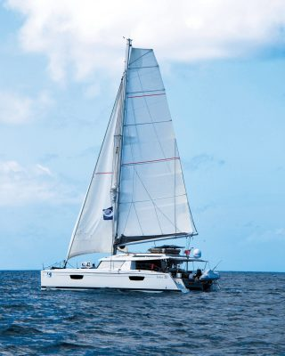 pacific-sailing-homeschooling-World-ARC2019-fountaine-pajot-saba-50-catamaran-RAID-side-view