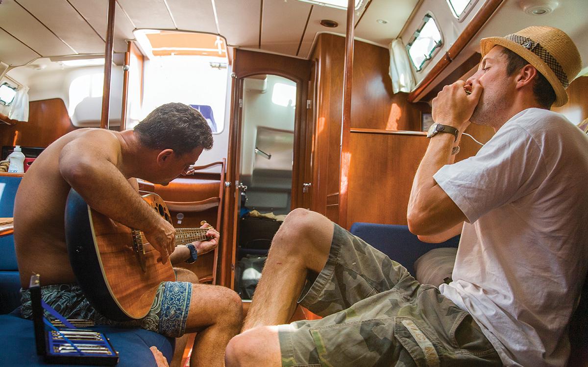 boat-hitchhiking-crew-playing-music-credit-Tor-Johnson