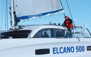 jimmy-cornell-electric-catamaran-helm-credit-Gilles-Foucras-Outremer