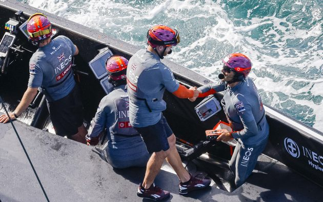 British America's Cup team sailors congratulate each other on a job well done