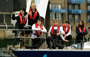 Ellen MacArthur with children of the Ellen MacArthur Trust onboard Scarlet Oyster sail into London under Tower Bridge today as
