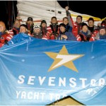 Ambersail, from Lithuania celebrate their arrival in Cowes after the finish of the Sevenstar Round Britain and Ireland Race.