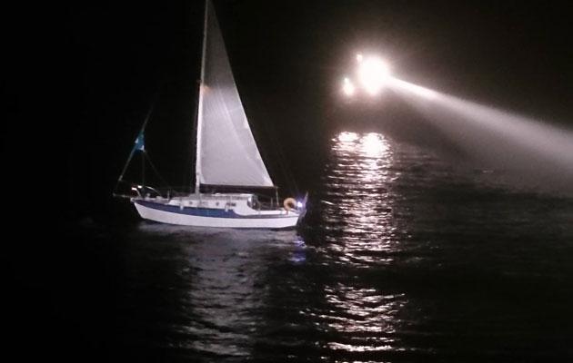 Yacht in fog off Torbay