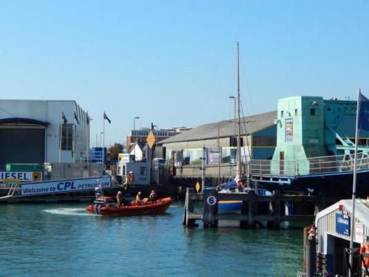 RNLI rescue boat pinned against Poole bridge