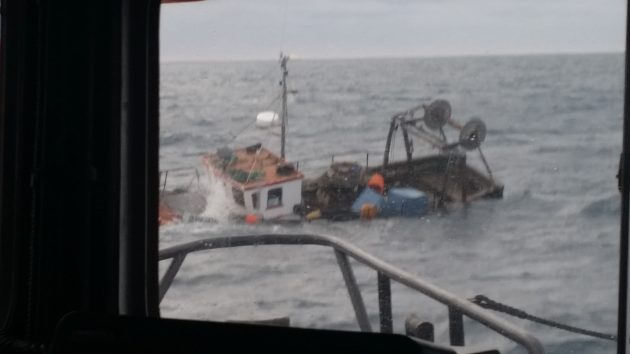 Two fishermen were rescued after their boat sank in the Atlantic