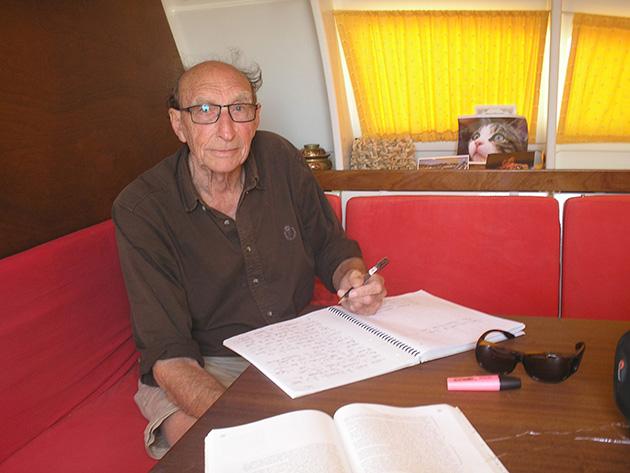 James Wharram writing his new book aboard Pahi 63 'Largyalo'