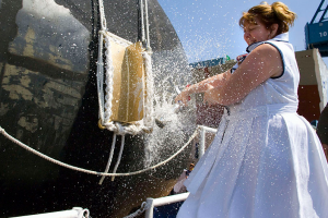 Debra Dunham, mother of late Cpl. Jason Dunham and ship's sponsor breaks a bottle of champagne across the bow of the Arleigh Burke-class guided-missile destroyer Jason Dunham (DDG 109) during the ship's christening ceremony at General Dynamics Bath Iron Works in Bath, Maine. Dunham posthumously received the nation's highest military honor, the Medal of Honor for his actions on April 14, 2004 in Karabilah, Iraq