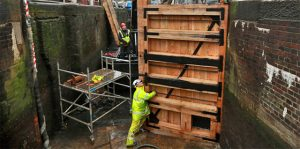 Fixing lock gates part of winter repairs on canals.