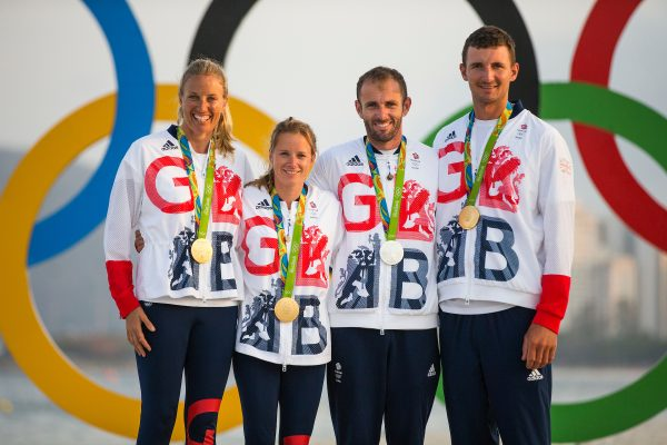 Hannah Mills, Saskia Clark and Giles Scott, pictured with silver medallist, Nick Dempsey.