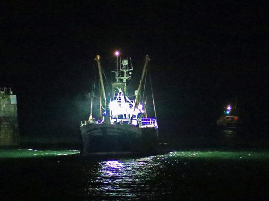 Douglas lifeboat Sir William Hillary escorts the fishing boat into Douglas Harbour. The skipper had DSC radio on board