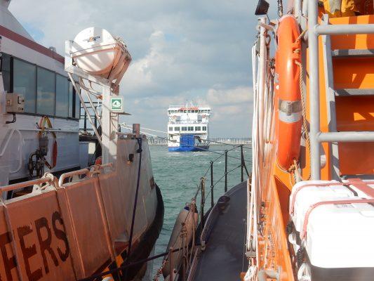 RNLI Yarmouth assist large trimaran in Lymington