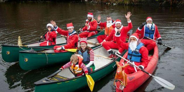 Canoeists taking part in Santa Splash