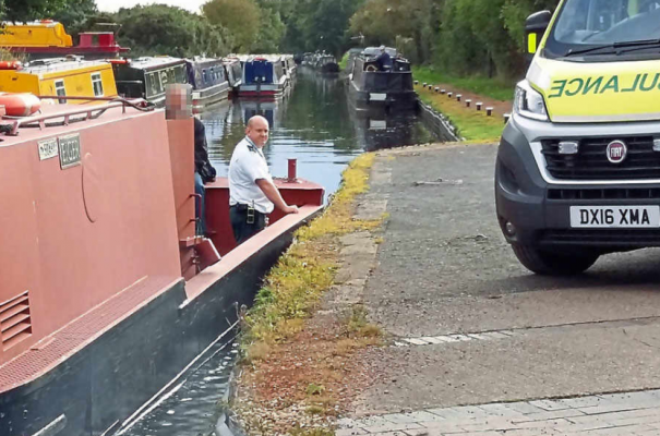 Paramedics use a narrowboat to transport casualty at Boggs Lock