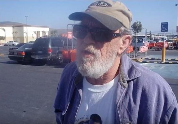 A man with a grey beard and baseball cap
