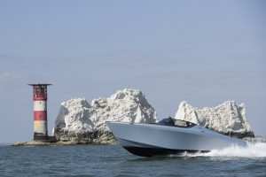 A powerboat speeding past the Needles, Isle of Wight