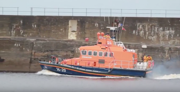 The RNLI lifeboat at Wick leaving the harbour