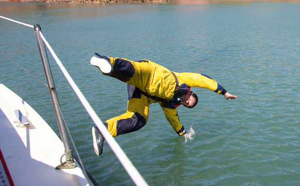 man falling out of a boat
