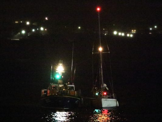 A yacht is escorted into harbout by Douglas RNLI