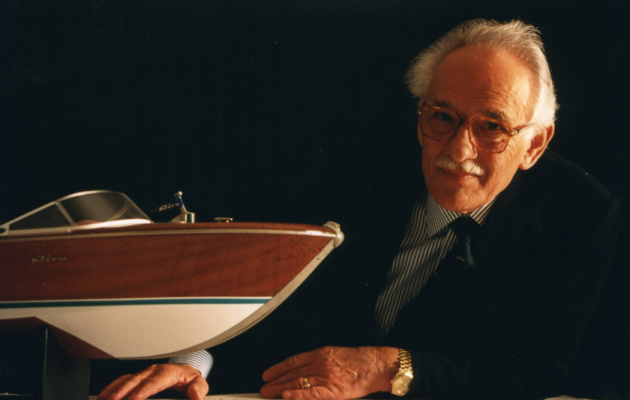 carlo riva with the model of a boat