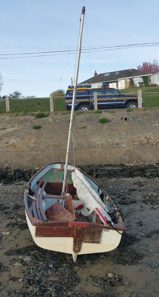 A dinghy on a beach in Wales