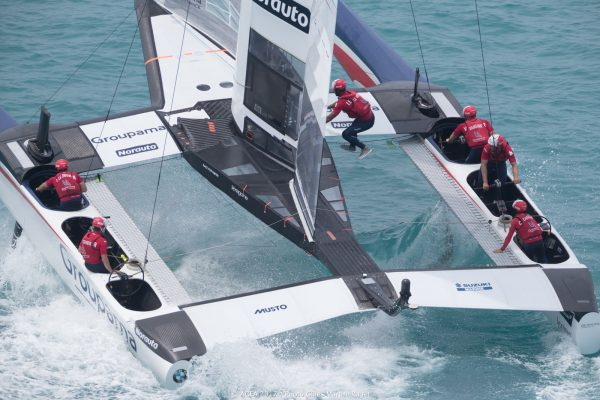 French sailors on a white America's Cup catamaran