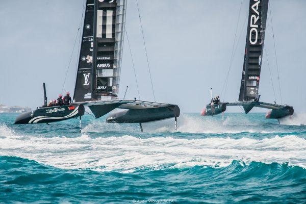two catamaran competing on water