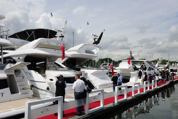 Visitors to the British Motor Yacht Show look at motor yachts