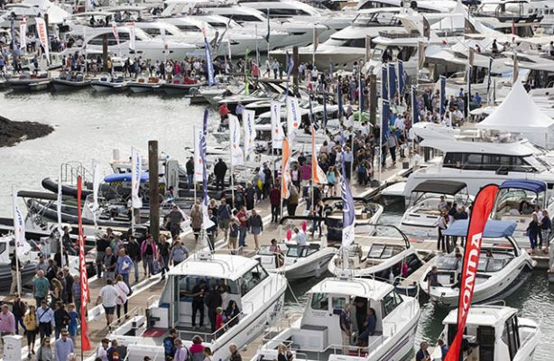 People walking among the boats at the Southampton Boat Show