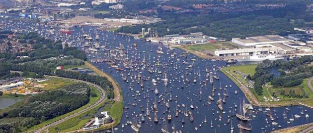 A parade of sail along a river