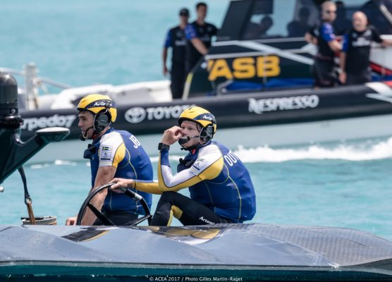 A helmsman in blue and yellow in an America's Cup cat