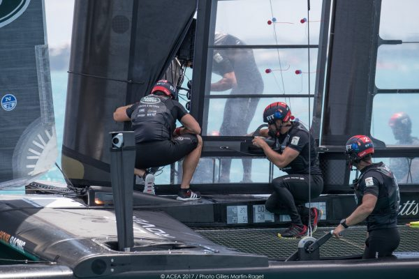 Sailors inspect damage to an America's Cup boat