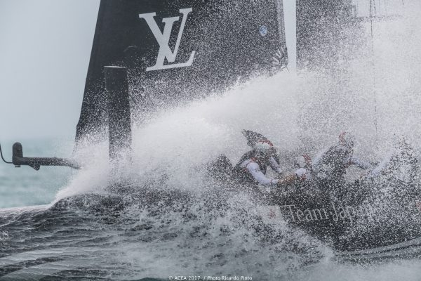 White water hits the deck of an America's Cup catamaran