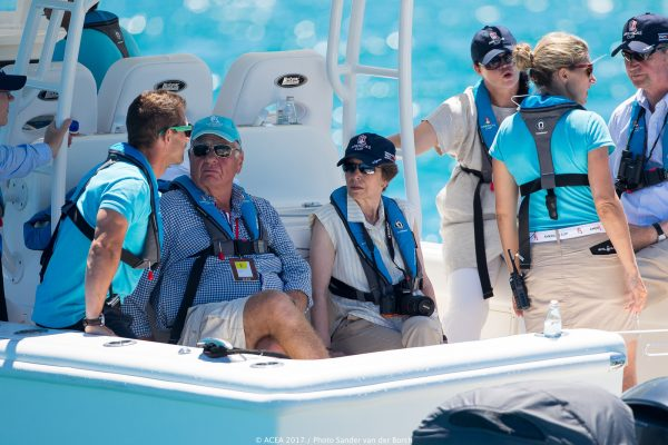 Princess Anne wearing sunglasses and a hat watching the America's Cup