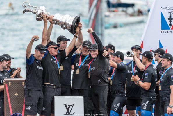 Dressed in black the New Zealand America's Cup team lift the silverware