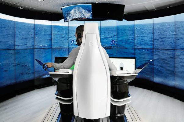A man sits in a white chair to test the world's first autonomous vessel from Rolls-Royce