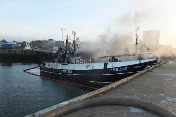 A fishing boat on fire