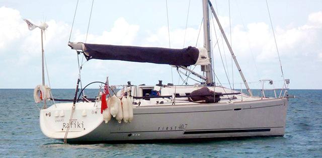 A white yacht at anchor with Cheeki Rafiki written on its stern