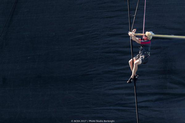 woman on yacht mast