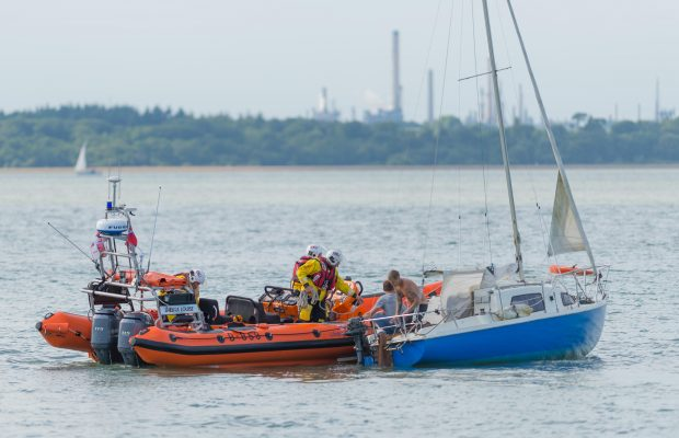 A yacht with two crew on board struggles in the Solent as the Cowes RNLI comes to assist