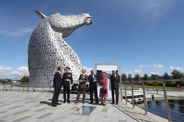 the queen standing by the Kelpies