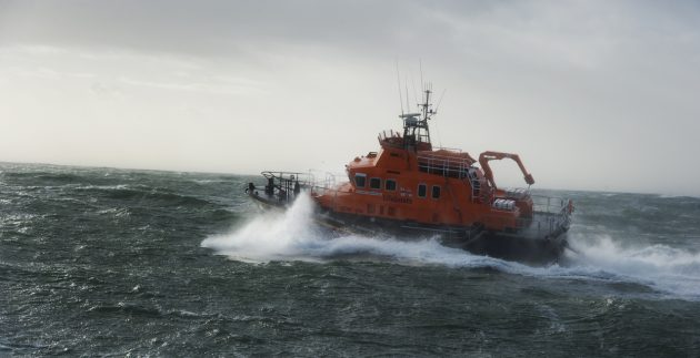 The orange all-weather Rosslare Harbour RNLI lifeboat leaving on a shout