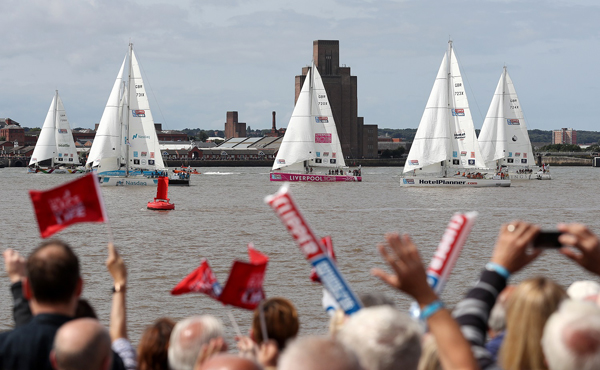 Crowds cheer at the start of the Clipper Round the World Yacht Race in Liverpool