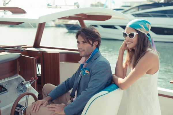 Two people on a motor yacht