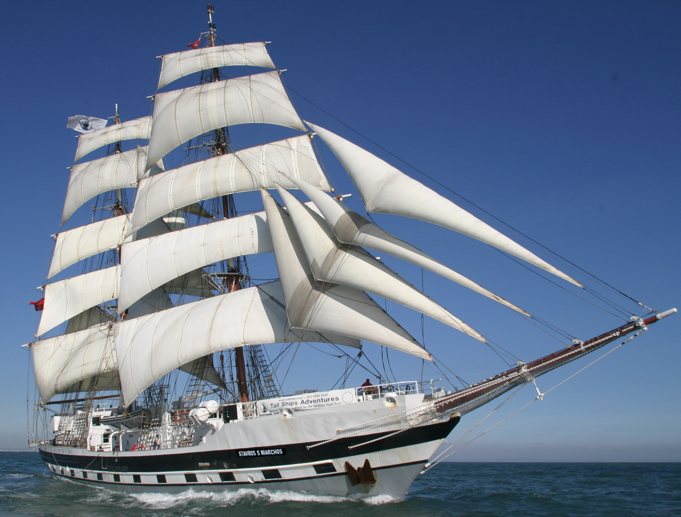 The tall ship- Stavros S Niarchos with white sails on the water