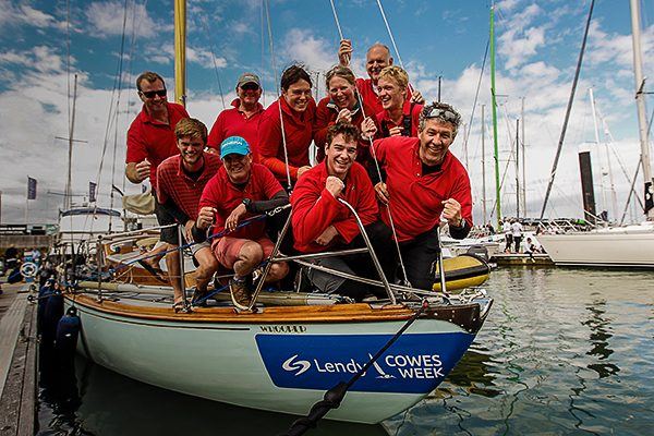Crew wearing red on board a yacht which was named the overall winner of Cowes Week 2017