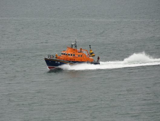 Two crew rescued from capsized boat off Plymouth as one remains missing