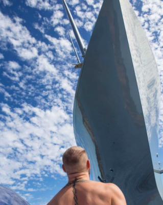 Conor McGregor looking at sailing yacht A