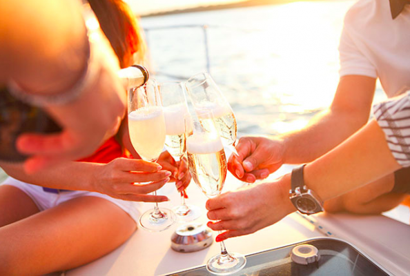people on a boat drinking champagne