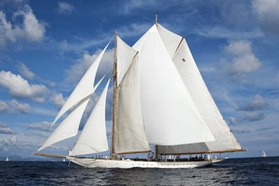 A superyacht with white sails