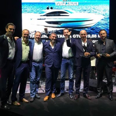 Staff at Fairline Yachts celebrating after winning an award at the Cannes Yachting Festival